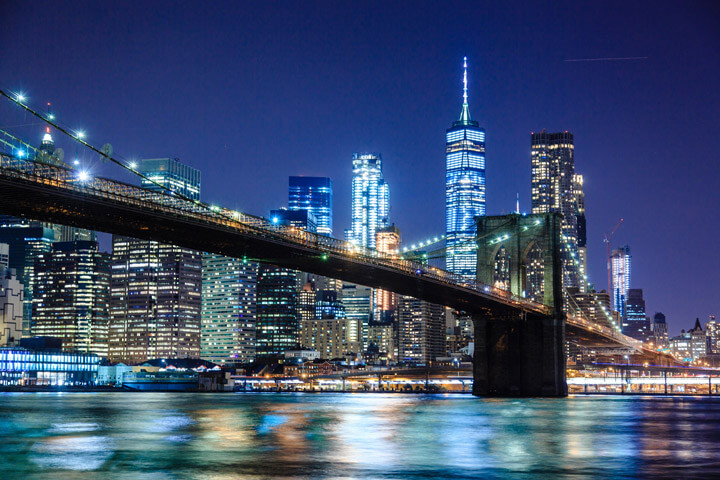Brooklyn Bridge at night with Manhattan Skyline