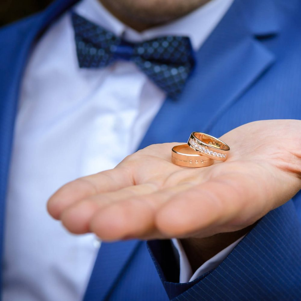 Wedding ceremony Best Man holding rings