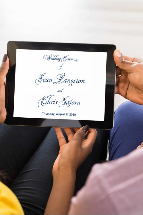 couple holding tablet and reviewing their wedding ceremony script