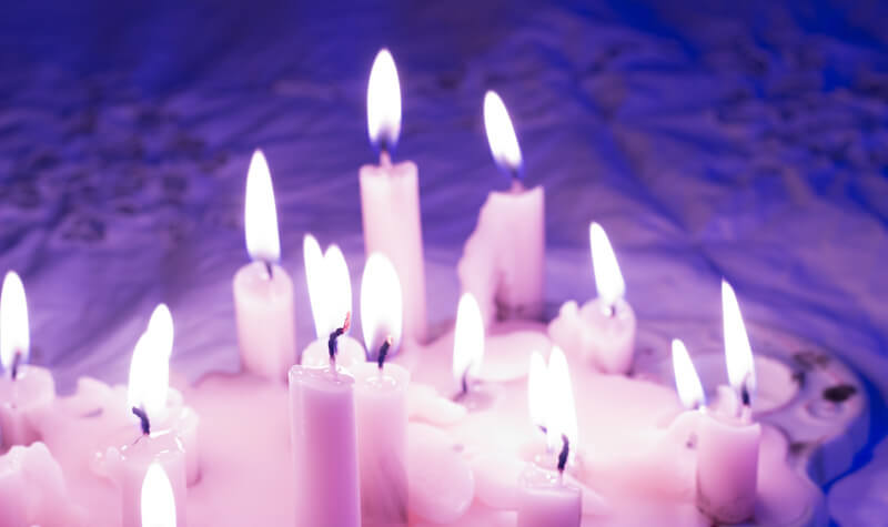 memorial candle service purples and pink
